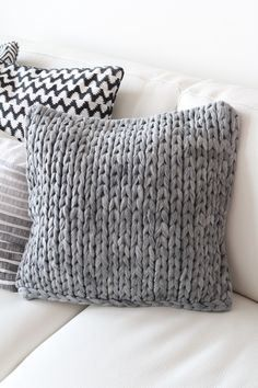 Big stitch pillow! We want it now! Ours thoughts here http://www.themodernknit.com/2014/09/15/use-modern-knitted-pillows-home/