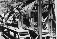 Women riveters working on bombers at the Chrysler Corporations De Soto Bomber Plant in Detroit, MI/1942.