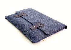 A simple and elegant laptop sleeve for a MacBook Pro. I love the leather straps.