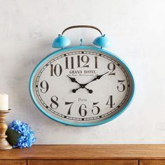 """Pier 1 Imports Turquoise #RetroStyle #WallClock. Description If retro style makes you tick, our turquoise clock is just the thing for you. Handcrafted of iron with a glass crystal, it's a large-format timepiece that will be easy to read from a shelf, counter or mantel. Multicolor 25.20""""W x 4.53""""D x 22.83""""H Wrought iron, glass paper, engineered wood, clock movement Dust lightly with a cloth or air duster 1 AA battery included To purchase more """"AA"""" batteries."""