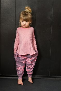 Oversized, Camoflage printed super stretch harem pants with pockets. So comfy, your little fashionista won't want to take them off. Preshrunk. Made in the beautiful USA.