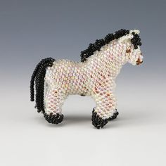 """Marvelous horse hand beaded by Zuni artist Anna Sarracino. Using one seed bead at a time, she creates this piece of beadwork with the peyote stitch. Anna signs her work with an arrow beaded into the piece. A wonderful addition to your Zuni Beadwork or Native American art collection. 2 1/8"""" tall x 2 3/4"""" long x 1 1/8"""" wide Artist card included"""