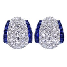 Platinum diamond and sapphire earrings consisting of 96 round brilliant cut diamonds weighing 7.68 total carats with color and clarity of F-G/VS and 32 square cut sapphires weighing 3.80 total carats. By Oscar Heyman. 35k USD