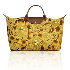 The Longchamp Le PliageR Leopard Flourish limited edition by Jeremy Scott is limited to 2500 worldwide. ACT FAST!