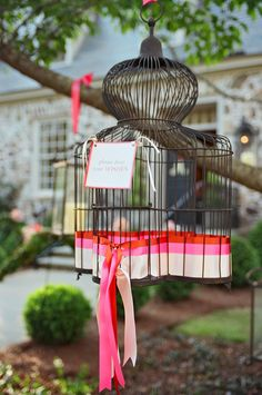 Bird cage guest message holder. Avoid long lines at large weddings and give your guests a chance to write wishes while waiting for the ceremony to start. They filled little mesh bags with a pen, a card to write wishes on, rose petals to throw at the end of the ceremony, and a miniature wedding program.