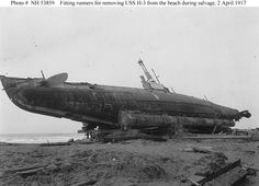 USS H3 being removed from a beach during salvage in 1917