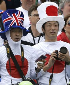 Fans watch the canoe slalom at Lee Valley Whitewater Center, at the 2012 Summer Olympics, Sunday, July 29, 2012, in London. (AP Photo/Kirsty Wigglesworth)