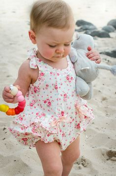 Baby Girls Romper Pattern. The Rose Bud Romper is a very special little summer romper for baby girls from 3 months to 3 years. Frilly and pretty with bow tie shoulders that allow for adjustment in the body length and snap fasteners at the crotch.
