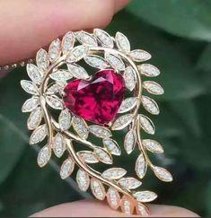 gem_passionRubelite Tourmaline 3.98ct set in a leafy gold pendant with diamonds.