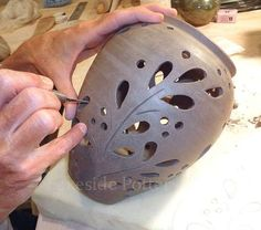 http://www.lakesidepottery.com/Media/JPG_Images/handbuilding-projects-ideas/lantern-curved-flowers.jpg