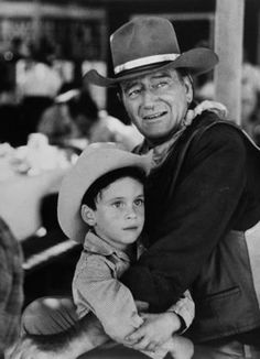 John Wayne starred in the film 'Big Jake' with his son Ethan playing the role of his grandson. (© Douglas Kirkland/CORBIS)