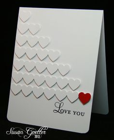handmade Valentine card by Susan Goetter ... clean and simple look ... rows of white on white die cut hearts ... the last one red ... great card ...