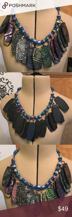 """RUSTIC WOOD AND BEADS NECKLACE-UNHOOKED ABOUT 19"""" RUSTIC WOOD AND BEAD NECKLACE-UNHOOKED ABOUT 19"""" LONG-COLORS OF BLUE, GREEN PINKS, PURPLE, RUST AND SOME SILVER-MEDIUM WEIGHT Jewelry Necklaces"""