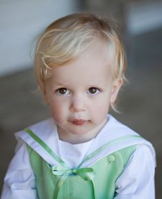 This lovely top comes with a sailor style collar, trimmed with satin ribbon and has 3/4 length sleeves.  A cute smart look for a christening or a mini pageboy!  Check out online to see the different colours! Designed by littleeglantine.com  #wedding