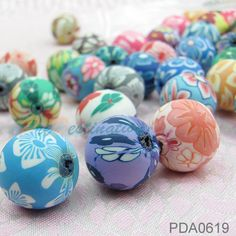 20 pcs Oriental Chic Collection of Various Pattern Fimo 18mm Huge Round Beads, Unbaked Polymer Clay Sections. $4.37, via Etsy.