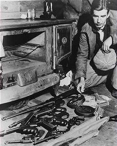 A few of the weapons used by American bank robber John Dillinger, abandoned in the Little Bohemia resort near Mercer, Wisconsin, after the outlaw escaped from a trap set by Federal agents, 24th April 1934.