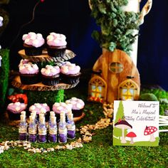 Super cute fairy party ideas: Mushroom cupcakes and woodstump stand etc.