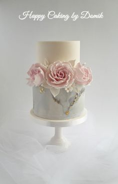 Birthday Cake Created for a lady who turned 60. I used marble effect, edible gold and my fav dusky pink roses.