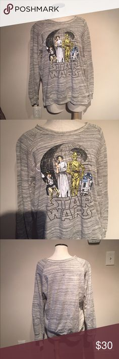 Gray Star Wars sweatshirt NWT gray Star Wars crew neck sweatshirt. Super soft and cuddly. Perfect for Star Wars fans and chilly nights. Size is large. Star Wars Tops Sweatshirts & Hoodies
