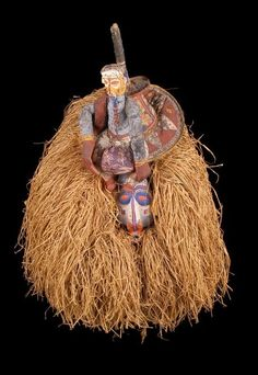 Africa | A 'Tundansi' mask worn during the circumcision ceremony by the Yaka people of DR Congo | 20th century | Wood, raffia fiber, pigments, clay and plant resin.