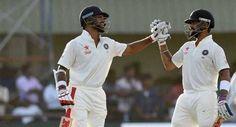 India resume steadily as Kohli, Dhawan punish Lanka