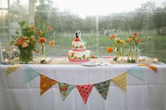 Love the colorful bunting on the white tablecloth! Photography by colormerad.net, Floral Design Day-Of Coordination by suzanmflorals.com