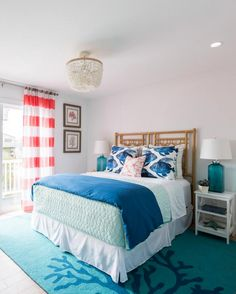 This coastal guest bedroom with a blue coral branch area rug, designed by Brother vs Brother (those HGTV guys) is so inviting and vibrant. It is part of an entire coastal home makeover.