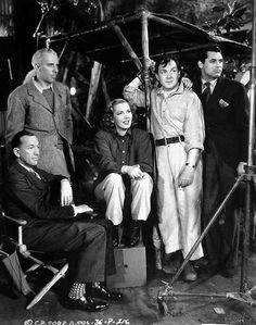 """Noel Coward [far left, seated] visits the set of """"Only Angels Have Wings"""" and poses with director Howard Hawks, Jean Arthur, Thomas Mitchell and Cary Grant Joseph Goodheart."""