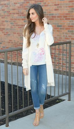 This Long lightweight cream knit cardigan pairs so easily with any outfit!