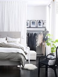 What a great idea: dont have a closet (or closet thats big enough)? Hang a curtain between two of the bedroom walls and install curtain rods or get industrial clothing racks and set up your own closet in the partitioned space. Plus the fabric wall adds interest to the rest of the room!
