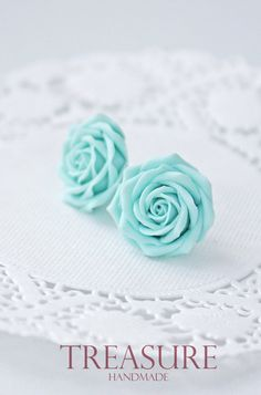 Light blue flower earrings.  Beautiful flower earrings with delicate blossoming light blue roses. Details: * Light blue rose stud earrings * Flower