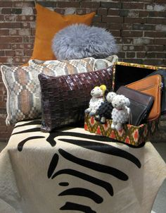 A little touch of fall in this set highlighting a prominent color of the season-burnt orange shown in our hide pillow.