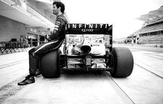 Mark Webber of Australia and Infiniti Red Bull Racing sits on his RB9 during an end of season team photo call ahead of the Formula One Grand... by Vladimir Rys (COTA 2013)