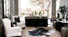 Londolozi Lodge -- Granite Suites -- Sabi Sands S. Africa.  Love the neutrals -- cowhide rug, slipcovers