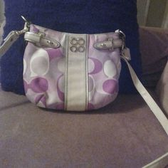 """Coach Baguette Small purse pink purple 9.5"""" x 7.5"""" Small Coach baguette ....shoulder strap......zipper top......inside pocket I HAD ATTACHED VELCRO TO IN ORDER TO KEEP THINGS FROM FALLING OUT ( if you do not like it, it is easy to detach the Velcro)........9.5"""" x1"""" x7.5""""..... Cream, pink,purple.....gold hardware...Excellent condition........20% OFF WHEN BUNDLED: 1)on item,click 'add to bundle'  2)Now click 'continue to shop in this store' 3)repeat 4)'buy bundle' 5)automatically discounts 20%…"""