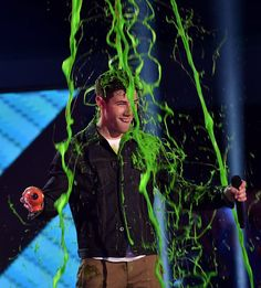 Pin for Later: See Stars Get Slimed at the Kids' Choice Awards! Nick Jonas The host with the most looked like he knew it was coming.