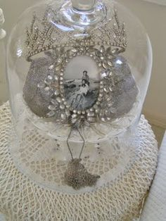 This inspires me...I'll put my wedding tiara, and a vintage style photo of me and my husband in a cloche, and place on top of my dressing table. <3