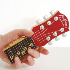 Air Guitar. So clever! Practice chord changes without the whole guitar