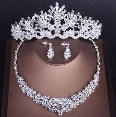 SPECIFICATIONS Metals Type: Zinc Alloy Gender: Women Material: Crystal Style: Trendy Included Additional Item Description: Crown&Necklace&Earrings Jewelry Sets Type: Bridal Jewelry Sets Fine or Fashion: Fashion Item Type: Jewelry Sets Occasion: Wedding Shape\pattern: PLANT Texture: Baroque Crowns Plated: Silver Crystal Bridal Tiaras Design: Wedding Accessories Style: Bridal Hair Accessories Model: Gold Rhinestone Crowns And Tiaras Type: tiara de noiva Model Number: tiara para noiva Numbe Women's Jewelry Sets, Wedding Jewelry Sets, Women Jewelry, Princess Jewelry, Headpiece Jewelry, Jewellery, Bride Hair Accessories, Bridal Stores, Bridal Tiara