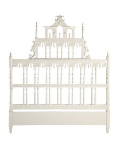Inspired by a flea market find, this elaborate headboard is one of those statement-making pieces that you could (and should) design an entire room around. We see Victorian references in the design and Indian influences in the delicate hand-carved detailing. Hand painted with a clean white finish that highlights each and every line.