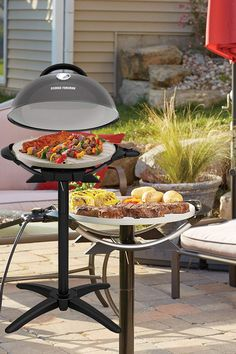 Rain or shine, it's always grilling time! The George Foreman Indoor Outdoor Electric Grill is perfect for backyard cookouts or family dinners at the table. Make up to 15-servings on the 5x more durable* non-stick ceramic surface. The Indoor Outdoor Grill is perfect for apartments, patios, and other areas where charcoal or propane can't be used, and you'll never have to worry about flare-ups! Versatile performance for a variety of delicious grilled foods—take home your George Foreman Indoor Outdo Best Electric Grill, Outdoor Electric Grill, Patio Set With Umbrella, Indoor Outdoor Grill, George Foreman Grill, Backyard Cookout, Outdoor Lighting, Outdoor Decor, Front Porch