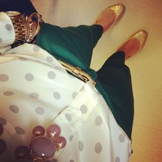 polka dot shirt, emerald green pants, gold flats and arm candy. That's my kind of outfit!