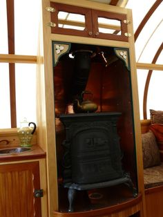 Artisan vardo stove enclosure allows close placement of flammables