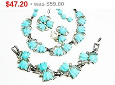 Kramer Blue Tulip Necklace Demi Parure Set with Bracelet & Earrings - Vintage Lucite and Rhinestones - Mid Century 1950's Jewelry by thejewelseeker on Etsy https://www.etsy.com/listing/269898702/kramer-blue-tulip-necklace-demi-parure