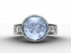Sky blue topaz engagement ring with white sapphires, made from white gold by TorkkeliJewellery, $1890.00