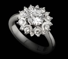 Engagement Ring from galway Jewellers in Ireland in a cluster halo setting in 18k white gold: