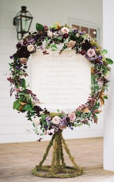 Purple floral wreath around reception menu