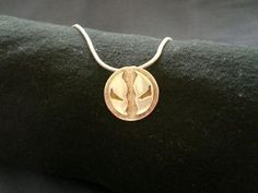 Silver and brass Spawn necklace