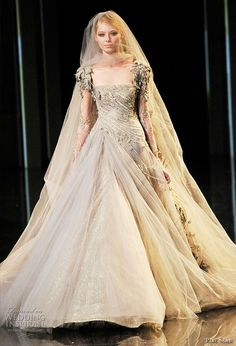 Celebrities who wear, use, or own Elie Saab Fall 2010 HC Dove Grey Gown With Lace Sleeves. Also discover the movies, TV shows, and events associated with Elie Saab Fall 2010 HC Dove Grey Gown With Lace Sleeves. Most Beautiful Wedding Dresses, Fall Wedding Dresses, Colored Wedding Dresses, Beautiful Gowns, Bride Dresses, Elie Saab Couture, Couture Wedding Gowns, Bridal Gowns, Gown Wedding