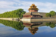 With its fascinating history, sprawling metropolis, incredible landscape and world class cuisine, China is truly a treasure - 7 day itinerary-A watchtower at the Forbidden City (QiuJu Song/Shutterstock.com)